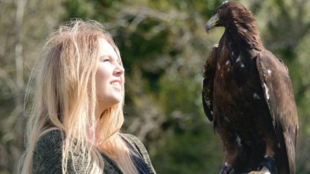 Sophie-Lee Williams with a Golden Eagle (falconry bird)