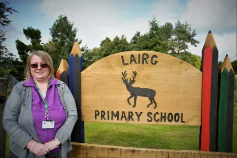 Lairg Primary School sign and Head Teacher Ruth Adams