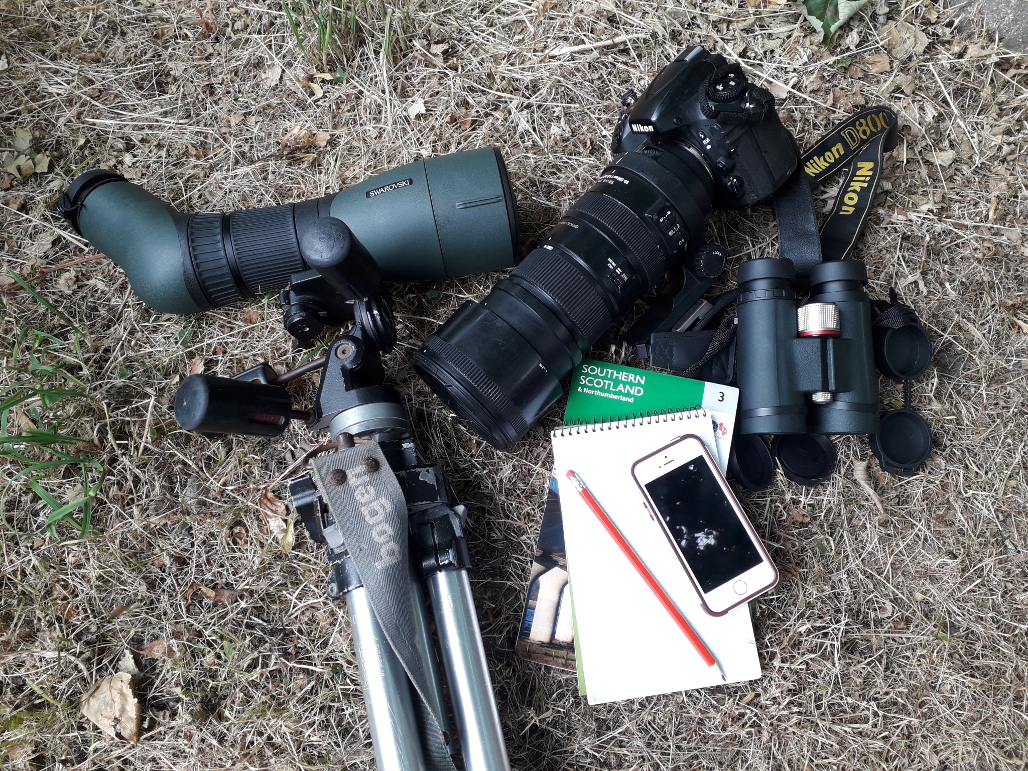 A selection of eagle spotting kit including binoculars and note pad