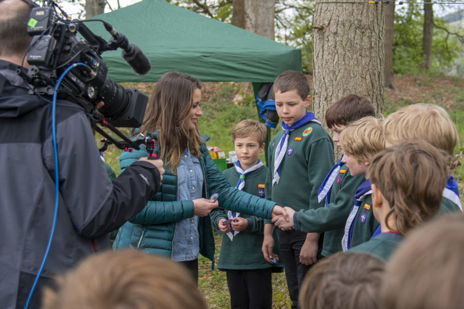 Cubs recieving their Eagle Champions badges from presenter Ann Lundon of BBC Scotland Landward