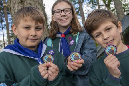Proud Cubs displaying their badges